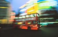 Bus at Piccadilly Circus at night. London. England