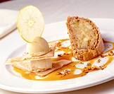 Phyllo roulade with apples and ice cream