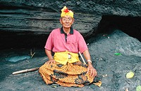 Old man guarding sacred cave. Tanah Lot Temple. Bali. Indonesia
