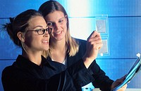 Two businesswomen looking at two samples