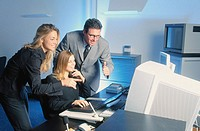 Three businesspeople in front of computer