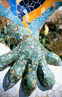 Detail of the dragon's hand  that guards the entrance to Güell Park (Gaudí, 1900-1914). Barcelona. Spain