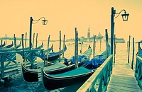 Gondolas in front of Piazzetta San Marco, San Giorgio Maggiore in background. Venice. Italy