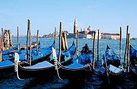 Gondolas in front of Piazzetta San Marco. San Giorgio Maggiore in background. Venice. Italy
