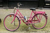 Pink bike in street. Amsterdam. Holland