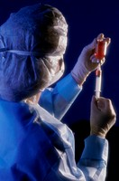 Female Technician Loading a Syringe