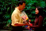 Asian couple  exchanging gifts and flowers.