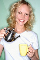Woman pouring tea in cup