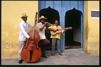 Cuban musicians playing in a streets of Trinidad de Cuba. Cuba