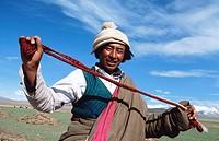 Nomad man with catapult. Nam Tso Lake. Tibet