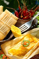 Tamales (corn gruel in maize leaves)