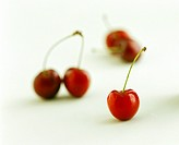 Five Red Cherries with Stems