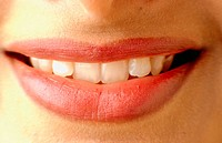 Gentle smiling lady with teeth showing
