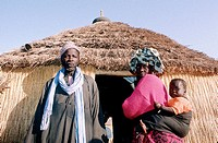 Family at their hut entrance in the village of Garabou-Niass (Wolof tribe). Cayor. Senegal
