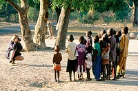 Group of children being photographed by a young european woman in Casamance. Senegal