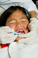 Girl having her teeth cleaned