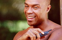 Smiling man holding cell phone