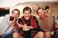 Men each try to watch their own TV program