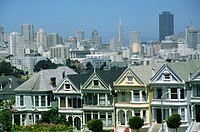 Victorian Houses in Alamo Square. San Francisco skyline at the background. California. USA