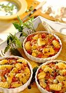 Gnocchi & tomato gratin with spring onions in gratin dish