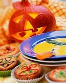Pumpkin soup & Halloween muffins with pumpkin in background