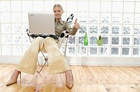 Business woman working with portable computer (thumbnail)