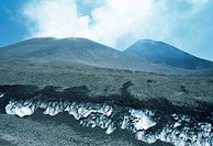 ´Mount Etna summits. Cratere di Sud-est (right) and Bocca  Nuova (left) summits of Mount Etna volcano, Sicily,  Italy. Ash covers snow in the foregrou...