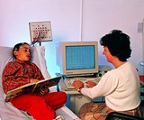 Electroencephalography.    Doctor monitoring   a  young  boy´s brain activity (brain waves)  using  an    electroencephalography  (EEG) machine. The b...