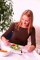 WOMAN EATING SALAD<BR>Model.