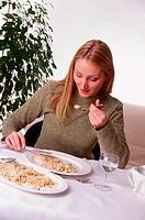 WOMAN EATING FISH<BR>Model.