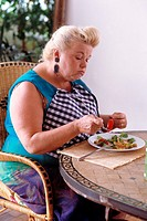 WOMAN EATING<BR>Model.