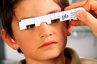 OPTICIAN<BR>Model.<BR>Measuring the distance between the eyes.