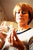 ELDERLY PERSON TAKING MEDICATION<BR>Model.
