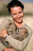 Woman with young leopards (Panthera pardus)