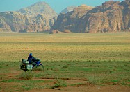 Jordan, motorcyclist riding through mountainous region