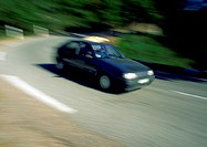 Car travelling around a curved road, blurry