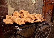 Syria, pita bread being sold, placed on bicycle