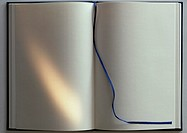 Open book with blank pages, blue ribbon marker