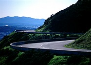 France, Corsica, road curving around mountain