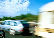 Station wagon with mobile home attached, blurred motion