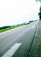 White lines on road, low angle view, tilt