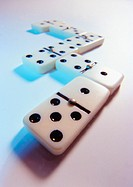 Dominoes on white surface, close-up