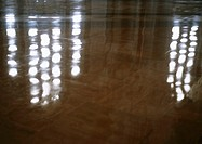 Lights reflected on marble floor