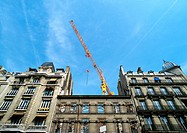 Building facades with crane, low angle view