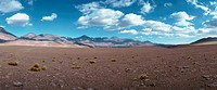 Chile, desert landscape, mountains in background, panoramic view