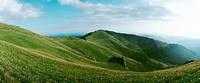 France, grassy plateau, moutain ridge in background, panoramic view