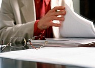 Person holding documents, blurred