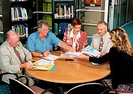 Five people sitting in conference room