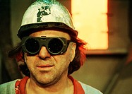 Man wearing hard hat and protective glasses, portrait