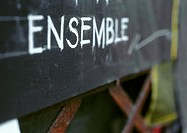 'Together' text in French, on blackboard